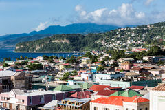 Colorful Buildings and Hills of Dominica. Colorful buildings in the coastal Caribbean town of Rosseau Dominica royalty free stock photo