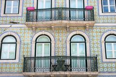 Colorful buildings, houses blue and green in Lisbon, Portugal. Old windows and Balconies popular and famous view. stock photo