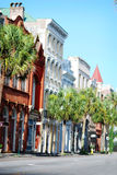 Colorful buildings line the street of palm trees in downtown Charleston, South Carolina. Royalty Free Stock Image