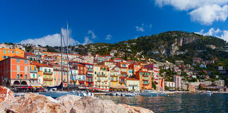Colorful buildings on the main quay of town Villefranche. France Stock Photos