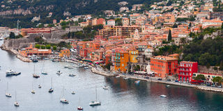 Colorful buildings on the main quay of town Villefranche. France Stock Photo