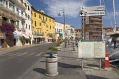Colorful buildings and main street near harbor of Portoferraio, Province of Livorno, on the island of Elba in the Tuscan Archipela Royalty Free Stock Photo