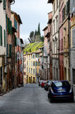 Colorful buildings on narrow street uphill, Siena Royalty Free Stock Photography