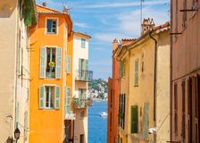 Colorful buildings in Nice on french riviera, cote d`azur, southern France. Typical architecture in southern France near Nice Stock Photos