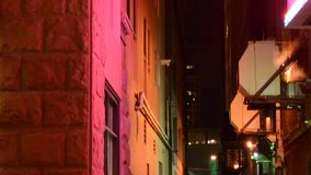 Colorful buildings at night stock footage