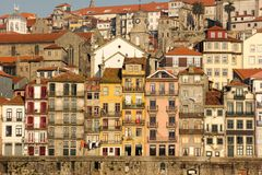Colorful buildings in the old town. Porto. Portugal. Picturesque and colorful buildings with iron balconies along Cais da Ribeira street by the river Douro royalty free stock image