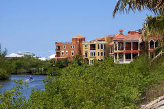 Colorful buildings over water. Row of colorful buildings curve off into the distance above a river in this scenic tropical  florida image Royalty Free Stock Images