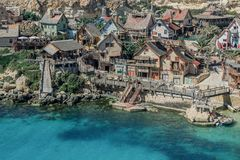 Buildings in Popeye Village in malta. Colorful buildings in Popeye Village in malta Royalty Free Stock Images
