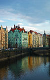 Colorful buildings of prague. With river and bridge Royalty Free Stock Photography