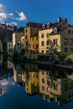 Colorful buildings reflecting in the Alzette - 1 Stock Image