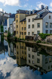 Colorful buildings reflecting in the Alzette - 3 Stock Images