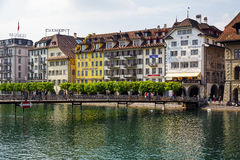Colorful buildings by river Reuss, Lucerne Royalty Free Stock Photography
