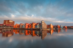 Colorful buildings on water in morning sunlight. Groningen, Netherlands Stock Photos