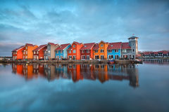 Colorful buildings on water  at sunrise Royalty Free Stock Photo