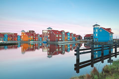 Colorful buildings on water at sunrise Stock Photo