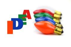 Colorful bulbs and idea text Stock Photos
