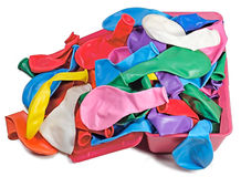 Colorful bunch of balloons in a box. Colorful balloons in large numbers in the box on the table Royalty Free Stock Image