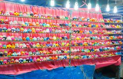 Free Colorful Bunch Of Little Dolls At Game Booth Winning Prizes For Dolls At Community Fun Fair. Royalty Free Stock Images - 122716879