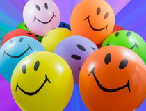 Colorful bunch of smiley balloons Royalty Free Stock Photography