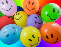 Colorful bunch of smiley balloons Royalty Free Stock Image