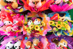 Colorful bunches of cute soft toys with flowers Stock Photography
