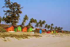 Colorful Bungalows on a Palm Beach Stock Image
