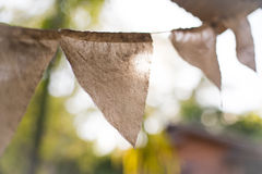 Colorful bunting flags hanging on tree with retro and vintage fi Stock Image