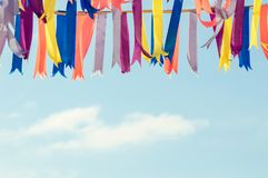 Colorful bunting party flags. In a sunshine day. Clouds on the background Stock Images