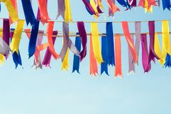 Colorful bunting party flags. In a sunshine day. Blue sky on the background Stock Photo