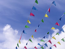 Colorful bunting in sky Royalty Free Stock Image