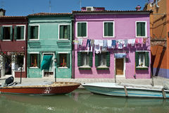 Colorful Burano Italy canal reflections Royalty Free Stock Photos