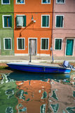 Colorful Burano Italy canal reflections Royalty Free Stock Image