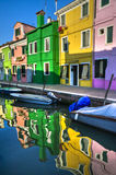 Colorful Burano Italy canal reflections Stock Photos