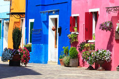 Colorful burano street. Bright yellow and pink and blue houses and the streets of burano island Stock Photos