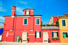 Colorful burano street. Bright yellow and pink and blue houses and the streets of burano island Stock Photography