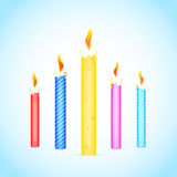 Colorful burning candles Stock Image
