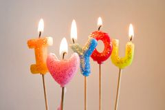 Colorful burning candles making I love you. Colorful burning candles making confesson I love you Stock Photography