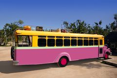 Colorful bus yellow and pink touristic tropical Stock Photography