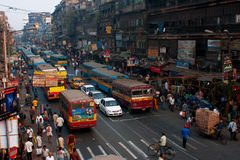 Colorful buses, cars and pedestrian on the street Stock Photos
