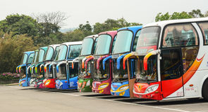 Colorful buses parking on the station. In Changsha, China. Start price is CNY 1 for common buses and CNY 1.5 for air-conditioned buses. Running hour buses is 5 Stock Photography