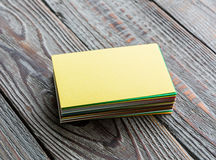Colorful Business cards. On wood table Royalty Free Stock Photos