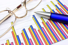 Colorful business chart. Blue pen and eyeglasses Royalty Free Stock Photos