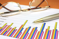 Colorful business chart. Eyeglasses and pen Royalty Free Stock Image