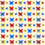 Colorful butterflies on light beige Royalty Free Stock Photos