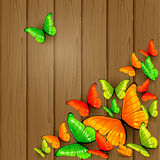 Colorful butterflies on wooden background Stock Images