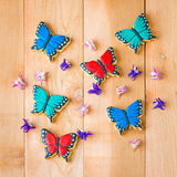 Colorful butterfly homemade cookies and flowers composition. stock photo