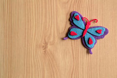 Colorful butterfly on rustic wooden Stock Photography