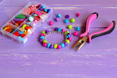 Colorful button bracelet craft. Simple crafting with buttons. Crafty way to use buttons for gift, accessory. Charm bracelet. Easy kids diy idea. Organizer with Stock Photography