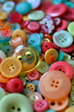 Colorful buttons. A large pile of buttons in pastel colors Stock Images