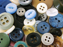 Colorful buttons. Scattered colorful buttons, needlecraft background Stock Photos